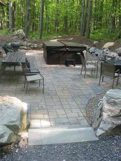 """daytime view of back patio and firepit area at """"Cabin in the Woods"""" Deep Creek Lake"""
