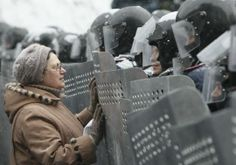 """Ukraine's prime minister said on Wednesday that anti-government protests had brought """"terrorists"""" onto the streets of Kiev and pledged to punish all """"criminal action"""", even as protesters confronted police near government headquarters. - A woman addresses Ukrainian Interior Ministry members who lined up during clashes with pro-European protesters in Kiev January 22, 2014. REU..."""