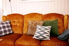 Autumnal pillows from H&M Home on my couch. tuulinenpaiva.fi