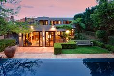 Lush landscaping and heated infinity pool