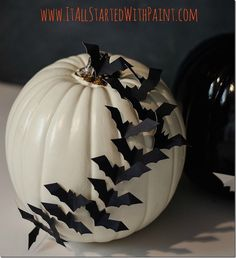 3D bat pumpkin: Cut bat shapes from poster board or cardstock and adhere them to the pumpkin with a no-mess glue dot.