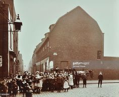 Crowd of East End children, Red Lion Street, Wapping, London, 1904. A group of children standing by a horse and cart at the entrance from Tench Street to a narrow lane.