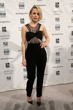 Rachel McAdams rocked a black cut-out jumpsuit with polka dot sheer mesh detailing and a bandeau top that she styled with a flipped side-part, red lip, and pointed black heels.