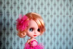 Blythe with raspberry pink dress and hair accessory