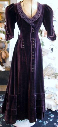 Purple cotton velvet nautical-style dress with cord embellishment and embroidered gold buttons (front), c. 1915.