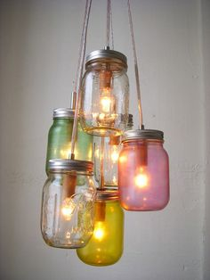 Mason Jar Shoot. How cute would this be outside with candles inside. Do you think I'd need to leave the top open? Are these coloured with glass paint? I really want to do this for my backyard.