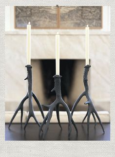 Antler Candlestick. We used real Whitetail deer antlers as the prototypes for these wonderful candle holders. Decorative antlers are cast in recycled aluminum with a dark bronze finish and transformed into sculptural candlesticks.