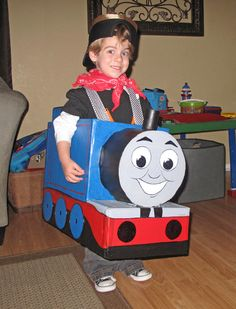 Step by step with images for making thomas the train halloween costume out of a box and paint