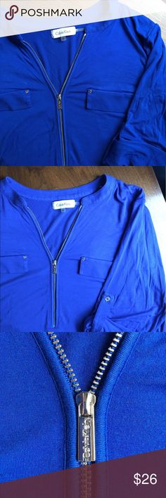 Calvin Klein roll sleeve shirt Royal blue Calvin Klein shirt with 3/4 roll sleeves and a 1/2 zip front.  Zipper pull is logo printed.  Faux front pockets.  Super soft and comfy rayon/spandex blend (95%/5%).  Like new condition. Calvin Klein Tops Tees - Long Sleeve