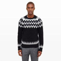 """Surviving frigid temperatures feels easy with our Lopi crew—an ultra-plush pullover spun in a merino blended yarn. Jacquard and jersey stitching lends rich texture to a classic Fair Isle motif. Wool blend Straight fit 27"""" back length; 30 ½"""" sleeve length Crewneck; rib knit at collar, cuffs, and hem; Fair Isle motif Dry clean Imported"""