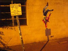TIMING IS EVERYTHING by ABOVE. It took nearly 7+ months searching the streets at night for a fixed shadow that was positioned perfectly against a wall. The break dancer stencil comes to life at night. I am attracted to the concept that the stencil and it's context can change literally from day to night. Timing is everything!