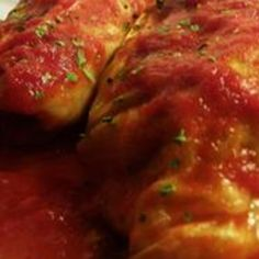 Easy Stuffed Cabbage Rolls ~ * 1/3 c uncooked white rice * 2/3 c water * 8 cabbage leaves * 1 lb lean ground beef * 1/4 c chopped onion * 1 egg, slightly beaten * 1 tsp salt * 1/4 tsp ground black pepper * 1 can (10.75 ounce) condensed tomato soup * 8 slices bacon