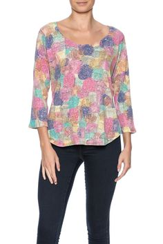 Multicolor dot printed top with a high low hem 3/4 sleeves and a round neckline.Hand wash. Lay Flat to dry.  Printed High Low Top by Nally & Millie. Clothing - Tops - Long Sleeve Clothing - Tops - Blouses & Shirts Cape Cod Massachusetts