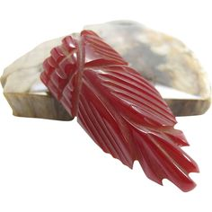 Vintage Carved Red Bakelite Dress Clip from thevintagegenie on Ruby Lane