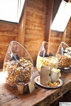 popcorn bar! be still my heart!Great for snacking before the wedding while everyone is arriving. My man's favorite snack.