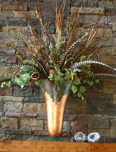 Large floral arrangements Love the different textures and especially the urn