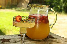 Summer Breeze Tropical Punch    1 lb frozen strawberries   2 1/2 C pineapple juice   2 C prepared lemonade   2 liter lemon lime soda     For an Adult Version   1 C lemonade and 1 C vodka or Champagne instead of soda    1.Put Frozen Strawberries in your favorite pitcher or punch bowl   2.Pour in pineapple juice and lemonade   3.Slowly add in lemon lime soda (beware the fizz factor)
