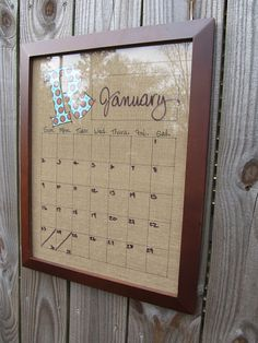 Burlap, Sharpie grid, fused monogram letter, glassed frame, write on with dry-erase pens to change the days and month