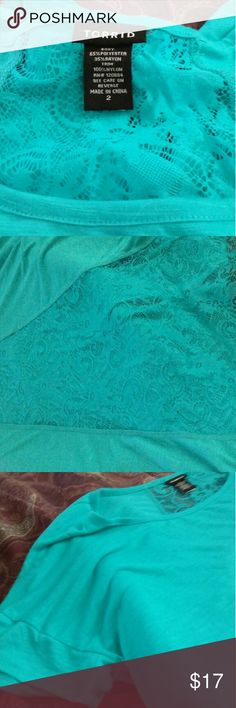Torrid pale green top size 2 Torrid pale green top with lace back size 2 never worn torrid Tops Blouses