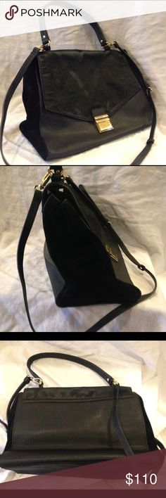 """Badgley Mischka leather/calfhair crossbody satchel Crossbody satchel w/ removable strap. Made of leather, suede, & calf hair w/ gold hardware. Some calf hair has worn off. Please see pics & additional pics listing before deciding to purchase. Interior is in great condition, is taupe, & has 2 open pockets & 1 zippered pocket. Black w/  gold hardware, which is a little worn. Dimensions are about 12"""" wide, 9"""" tall, & 5"""" deep. Top handle has about a 6 1/2"""" drop, removable crossbody strap has…"""
