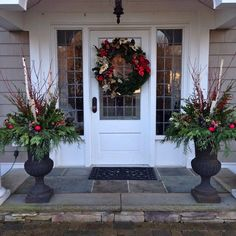 It's beginning to look alot like Christmas! #greenchristmas #frontporch #entryway #containers #wreaths #greenery #red #christmas