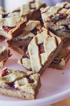 These buttery, nutty cookie sandwiches have a peekaboo cutout at the top to showcase the jewel-toned jam nestled inside, all dusted in powdered sugar. Freezable! Better when thin cookies