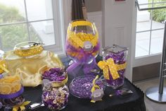 Yellow and Purple Candy buffet, with accents of black damask and polka dot! I don't like the purple and yellow so much but we could customize. Love the dif sizes and shapes!!obvy needs to be pink n orange
