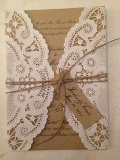 Our perfect vintage chic wedding invitations printed on kraft paper, wrapped with a lace paper doily, and tied up with jute ribbon.