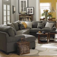 Left Cuddler Sectional -- love the idea of a gray couch... yellow looks great; kelly green would be an awesome accent color too. or brick red. so many options!