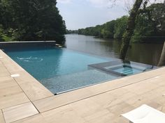 Negative Edge Pool | Inground Pool & Spa | Automatic Cover | Mill Bergen Pools