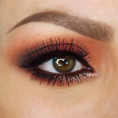 Use Mary Kay's mineral eye shadow in copper glow and sweet plum with crystalline in the corners for highlight :)