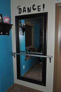 Easy Ballet Bar.  All you need is a full length mirror, 6 inch shelf supports, and a wooden dowel.