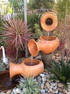 1339439088_365543228_7-Cascatas-e-Fontes-para-Jardins-Brasil.jpg (469×625)