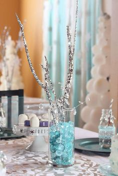 Lovely centerpiece at a Frozen birthday party! See more party planning ideas at CatchMyParty.com!