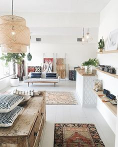 industrial meets boho chic+ antique rugs* lighting* unfinished wood* love the neutral palette*