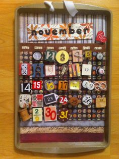 a cook sheet, scrapbook paper, and interesting objects repurposed into a reusable calendar