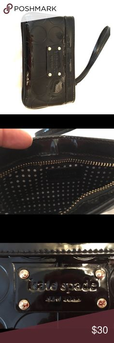 Kate spade wristlet Patent leather front logo wristlet with adorable polka dot interior.  Never been used, excellent condition. kate spade Bags Clutches & Wristlets