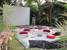 after cooking together enjoying a wonderful dinner party everyone can grab a pillow and enjoy a backyard movie night
