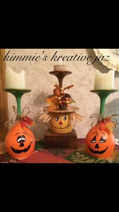 Pumpkin and scarecrow wineglass candle holders.