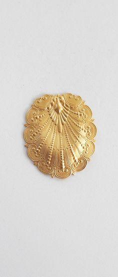 1 raw brass stylized art nouveau shell by GloriousGlassBeads
