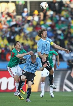Diego Lugano and Diego Perez - Uruguay, Guillermo Franco - Mexico; World Cup 2010