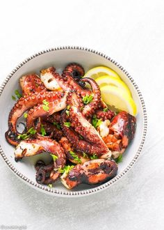 Easy Grilled Octopus Recipe - tender, lightly seasoned and charred octopus that tastes amazing! A must try for seafood lovers!