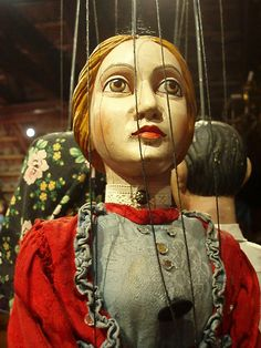 https://flic.kr/p/6V1jqQ | Puppet Chick | At an amazing puppet museum in Cesky Krumlov. The puppets were large & some of them were terrifying. The museum was a deconsecrated church, up in the attic near the belfry. To get to part of the shop you had to crawl through a doorway 3 feet high.