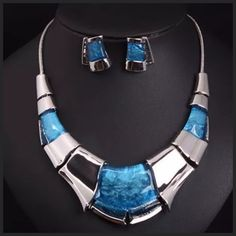 "D40 Blue Silver Marbled Acrylic Statement Necklace ‼️PRICE FIRM‼️   Marbeled Acrylic Statement Necklace  Retail $120   ABSOLUTELY GORGEOUS!!!  Beautiful marbled blue acrylic & silver color metal adorn this art deco statement piece. A true fashion statement. Necklace is approximately 20"" around including a 3"" adjuster chain. Free matching earrings.  Earrings hang down approximately 1"".Sure to dress up even the most basic outfit!  Perfect with an evening gown or a casual blouse!  So many…"