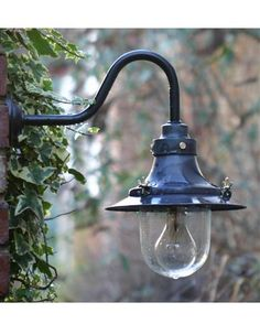 Weathered copper deck light on black powder coated swan neck. Expensive :(