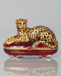 """#ONLYATNM Only Here. Only Ours. Exclusively for You. Handcrafted leopard box. Cast metal. Hand enameled and hand set with Swarovski crystals. 3.75""""W x 1.5""""D x 2.5""""T. Made in the USA."""