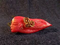 Red Lady Pendant, Red Feminine Jewelry, Red Woman pendant, Red Sculpted Necklace, Sculpted Cameo necklace, Red lady cameo, gift for her  $15.00  This lovely carved red brooch is the perfect accessory to match an elegant scarf or coat. The red clay brooch has been created in an Art Nouveau style.   The brooch measures aprox 3 inches (7 cm) long.  - hand sculpted from polymer clay - glazed with high quality resin for an unparalleled shine - painted with acrylics  - embossed with a golden tint… Pagan Jewelry, Fairy Jewelry, Geek Jewelry, Fantasy Jewelry, Etsy Jewelry, Custom Jewelry, Flower Jewelry, Diy Fimo, Game Of Thrones Jewelry