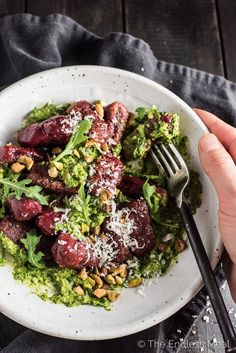 This easy to make Beet Gnocchi is as pretty as it gets. The little red clouds get nestled in some delicious arugula pesto and sprinkled with pistachios. It's festive colored and the perfect main dish recipe for holiday entertaining. | theendlessmeal.com Gnocchi Recipes, Pork Recipes, Vegetarian Recipes, Beet Recipes, Rice Recipes, Dinner Recipes, Roasted Beets And Carrots, Pistachio Crusted Salmon, Honey Glazed Chicken