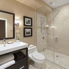 Darkwood Vanity Design also White Countertop in Beautiful Small Bathrooms with Woodframe Wall Mirror also Chrome Faucet