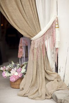 Burlap curtains with tie backs, use black and turq fringe